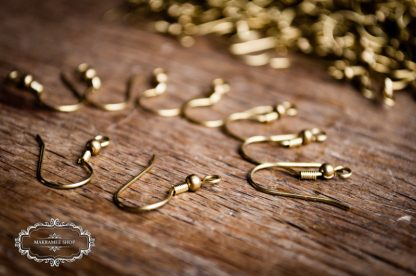 Ear hook brass decorated with bead and fine spiral.